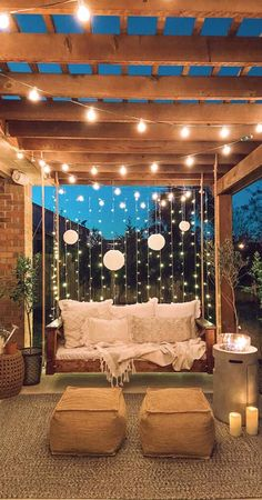 With some fairy-lights and a comfy, cozy swinging sofa, a simple pergola becomes the perfect place to enjoy your garden landscape. Pergola Swing, Outdoor Pergola, Backyard Pergola, Porch Swing, Backyard Landscaping, Pergola With Swings, Pergola With Lights, Garden Swings, Timber Pergola