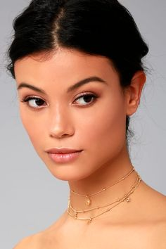 "Discover the stars in the Ettika Galileo Gold Layered Choker Necklace! This on-trend choker necklace features layers of 18k gold-plated chains, accented with beads, and star and moon charms. Shortest layer measures 9.5"" with a 5"" extender chain."