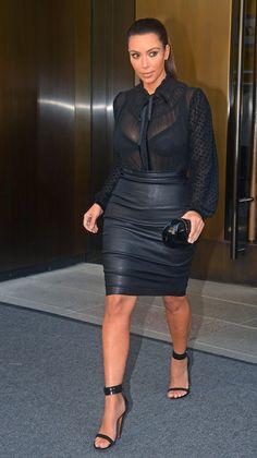 Kim Kardashian wearing a black sheer blouse and leather pencil skirt - would have something under blouse though