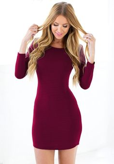 Front view of girl in burgundy crisscross back bodycon dress