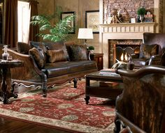 """The """"look"""" of brown sofas, light fireplace and dark tan walls with rug...."""