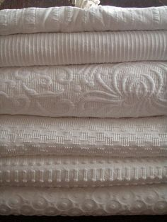 White Coverlets ~~~Third one down is mine-- made in Portugal, 100% cotton, with matching Euro-shams. Gorgeous!