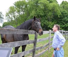 Bubba Sparks greets Migliore during the Eclipse Award winning jockey's visit to the TRF facility in NY.