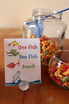 """Dr. Seuss-themed playtime party to celebrate Dr. Seuss' birthday. Seuss snacks were served and lots of """"props"""" including Dr. Seuss books and plush toys were arranged for a photo op. Each little guest received a framed Dr. Seuss quote that I designed wrapped in chevron paper."""