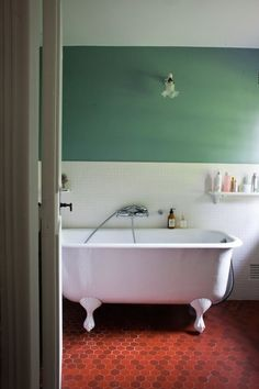 "Red tiles/ The downstairs bathroom features the beautiful and rare terracotta tiles, an iron bath, and more ""Oval Room Blue"" by Farrow & Ball. Bathroom Red, Downstairs Bathroom, Washroom, Bathroom Cabinets, Bathroom Remodel Cost, Budget Bathroom, Home Design, Design Ideas, Oval Room Blue"