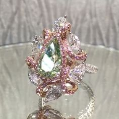 Another Very Unique Piece From A.A Rachminov Diamonds 2.5ct Pear Fancy Yellow-Green, With White And Pink Diamonds.