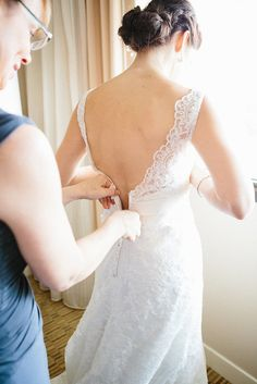 "It's one of the last finishing touches before the bride says ""I do"" and an important duty of being her right-hand gal.   Photo by Valo Photography via Style Me Pretty"