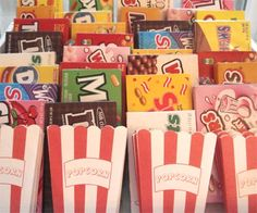 make a concession stand with pizza, popcorn, the cake (or cupcakes), movie theater candy, & drinks