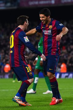Luis Suarez of FC Barcelona celebrates with his teammate Lionel Messi of FC Barcelona after scoring his team's fifth goal during the La Liga match between FC Barcelona and Levante UD at Camp Nou on February 15, 2015 in Barcelona, Catalonia.