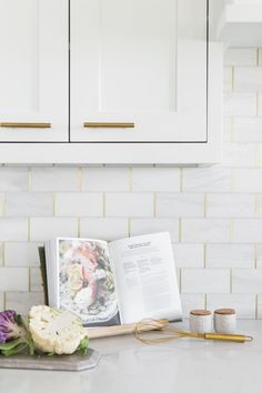 Love this backsplash idea. Marble subway tiles with brass schluter strips between tiles.
