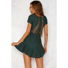 Our Make Me Proud Dress won't disappoint! Promise! It features a t-shirt like neckline and sleeves, with the attention drawing to the ruffled skirt. The back is the real show stopper with it's cut out detailing. The waist is elastic supported by an invisible zipper running through the back for ease of wear. We love pairing ours with gold accessories! Forest green dress. Not lined. Cold hand wash only. Model is a standard XS and is wearing XS. True to size. Non stretchy fabric. Polye...