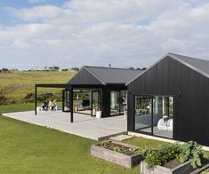 This black-clad home makes a bold statement on the outside, but inside it's warm, welcoming and designed to create the ultimate Kiwi childhood Modern Barn House, Barn House Plans, Clad Home, Steel Barns, Contemporary Barn, Black Barn, Shed Homes, Cottage, Affordable Housing