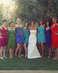 Jewel tone short bridesmaid dresses, multiple styles and colors.  Little too varied in style/fabric but love the color palette.