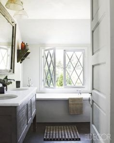 vanity in the master bath is a Huniford design, and a section of a wood conveyer belt serves as a bath mat