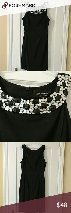 Sexy Little black dress Beautiful black and clear crystals curve around the neckline of this sexy fitted sleeveless dress. Full back zipper . Worn one time. Connected  Apparel Dresses Midi