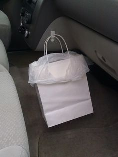 Stow Trash on the Go Stop receipts, wrappers, and plastic bottles from spilling all over your car by securing a bag to a discreet spot in the interior.