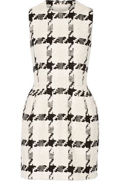 Heritage motifs are a key element in Alexander McQueen's Resort '17 collection. Made in Italy from tactile tweed, this mini dress is woven in a large-scale houndstooth pattern in shades of ivory, black and cream. It has a tailored fit, defined waist and discreet slit pockets. We'll be layering ours over a billowing white top.