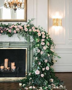 A garland of greenery and pale pink roses draped over a fireplace mantle serves as a dreamy #ceremony backdrop- the perfect setting for #fairytale-worthy #IDos! | Photography By: Simply Lace | WedLuxe Magazine | #wedding #luxury #weddinginspiration #luxurywedding #floral #floralarrangement #floralbackdrop #flowers #decor #decordesign
