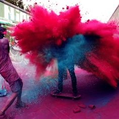Colour war with bright pink coloured powder in the streets of Berlin by photographer Kate Bellm.