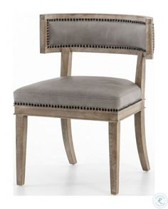 The traditional style Connor Dining Chair features unique curved back legs, bringing added visual imagery its design. Designed with luxurious cushions, this chair is comfortable as well as chic with its brass nailhead detail.