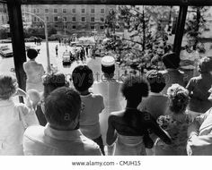 """Fans and hospital personel waiting inside """"Baptist Memorial Hospital"""" (looking at the Emergency Room) just before the anouncement of Elvis' passing, August 16th 1977..."""