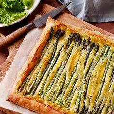 Spring Asparagus Tart : This seasonal recipe makes for a beautiful presentation. Cover store-bought puff pastry with a mascarpone mixture before topping with asparagus spears. via Food Network Tart Recipes, Veggie Recipes, Vegetarian Recipes, Cooking Recipes, Delicious Recipes, Entree Recipes, Dessert Recipes, Yummy Food, Asparagus Tart