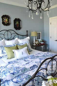 Love the mix of fabrics, colors, and decor in this Guest Room Makeover-Housepitality Designs