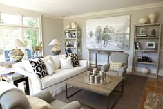 Neutrals, texture, layers  accent in black and white, large piece of art- recipe for a great space