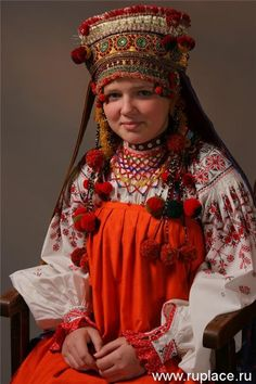 Russian head covering. A braid would always show as one of the attributes of female beauty.
