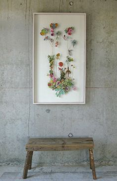 Artist Anne Ten Donkelaar creates amazing floral collages out of pinned pressed flowers, stems and paper cutouts. I'll say it again. Just amazing.