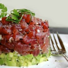 Tuna tartare with herbal-infused oil.