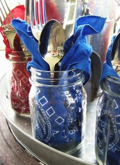 Mason jars filled w/ bandannas & silverware. Could be a glass after, although I sort of hate mason jar glasses. Maybe with a straw would be better? Mergh. Cute idea though except for that. Also, fabric napkins are easy peasy, and you could just do ripped square muslin for cheapies (like, not even hem them, just rip appropriate sizes, then iron).