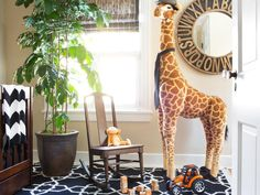 A tiny 9x7 second-floor bonus room was transformed into a little boy's nursery with careful space planning, a smart use of mirrors to reflect light, a mix of patterns and classic color choices.