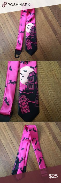 Haunted House Tie Pink and black haunted house tie. Unisex and great for every day wear, cosplay, etc. Brand new, only taken out of the plastic for photos. Features a haunted house, a gravestone, a full moon and bats. Super unique. Has a little loop in the back to hold down the excess material once tied. Tags: kawaii anime cosplay lolita hot topic dollskill japan japanese bodyline angelic pretty baby the stars shine bright visual kei pastel goth fairy kei unisex gothic lolita halloween…