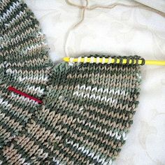 This spiral afghan is made in Tunisian crochet in knit style. It features a spiral with increasing band width, like a shell. Note that one ball of yarn had a different pattern of variegation and led to a bold look to one arc. This afghan works well as a sofa throw or sit-upon because it is thick and heavy.