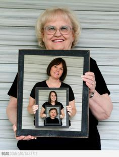 A picture of the generations inside a photo of grandma holding a framed daughter and grandchild photo.
