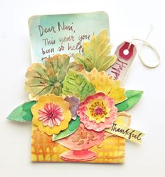Brenda Walton - Designer Mou Saha creatively combined three different coordinating dies for her Thankful Notes: Library Pocket, Millinery Leaves, and Tea Cup Bouquet. Mou's whimsical watercolor washes beautifully highlight the embossing folders that are included with the dies.