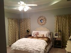 Finished Room!  Blue walls, ruffled bedding, mirrored end tables, rustic chic.