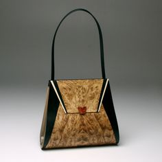 Mark Diebolt and his exceptional wood and leather handbags will be at the Smithsonian Craft Fair, November 27-30.