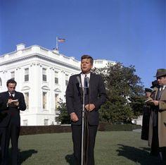 The President speaks to the press outside the White House following  astronaut John Glenn's successful orbital flight (February 20, 1962).