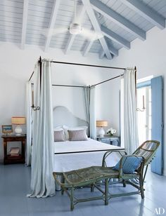 Embrace curtains. If you're lucky enough to have a four-poster, add drapery in a summery seersucker pattern for instant seasonal charm.