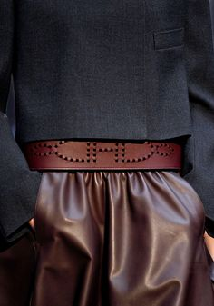 Brown Leather Skirt matched with Dark Charcoal Grey Top. #brownfashion