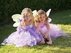 """Girls Costumes Butterfly Fairy Princess Dress Up Birthday Girl Dresses Halloween Costumes -- Purple Small (1y-2y) by Heart to Heart Gifts. $16.99. Flowers and pearls adorning the neckline and strands of tulle makes this fairy costume (100% tulle) something to twirl about. Includes a knee-length slip inside. It is a magical dress that will transform her into an enchanted fairy princess. Our """"super models"""" chose this dress as their favorite!"""