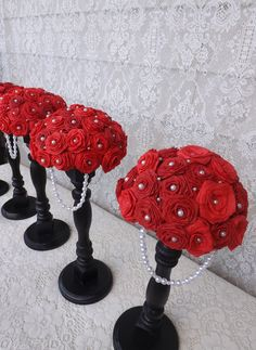 Black Red and White wedding centerpieces. Paper red roses with pearl accents.