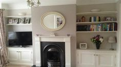An inspirational image from Farrow & Ball. Alcove in Skimming Stone. Chimney breast in Elephant's Breath. No note on the trim. Farrow And Ball Living Room, Living Room Paint, Living Room Grey, Home Living Room, Living Room Designs, Living Room Decor, Farrow Ball, Chimney Decor, Elephants Breath