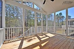 Screened porch with space for hammock and dining table.