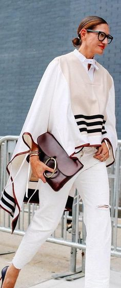 Jenna Lyons in a cream poncho with a burgundy bag