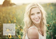 senior portraits in a sunflower field