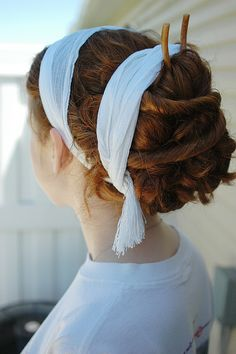 Greco-Roman hairstyle. lovely striking hair style. im actually wondering if i can pull off those headbands?