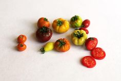 10 types of delicious Heirloom Tomatoes, in miniature. From left to right and…